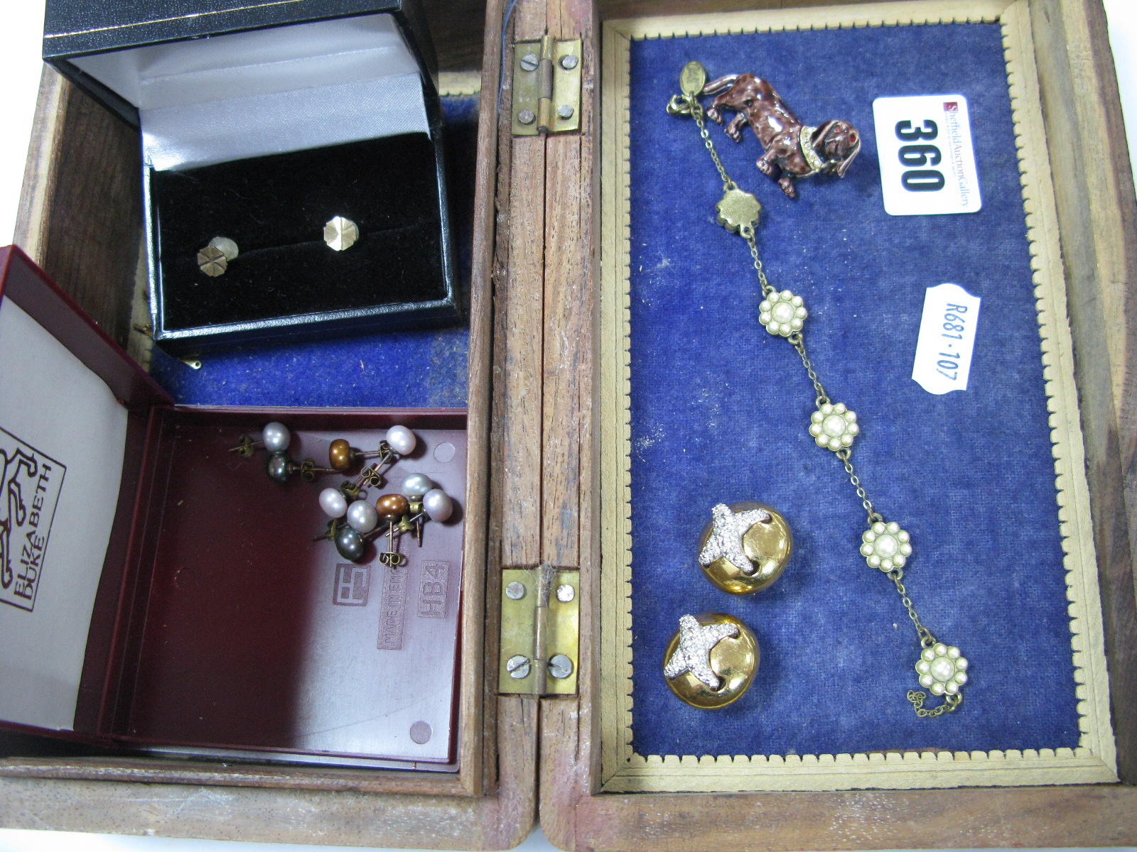 """Lot 360 - A Pair of Circular Clip Earrings, with inset cross design, stamped """"Swarovski"""", a vintage style"""