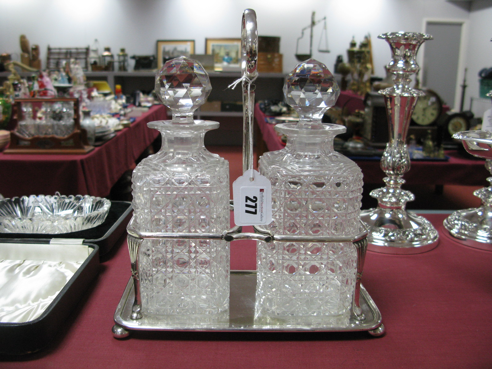 Lot 277 - A JBC&SLtd Plated Two Bottle Decanter Stand, fitted with cut glass stoppered decanters, the stand