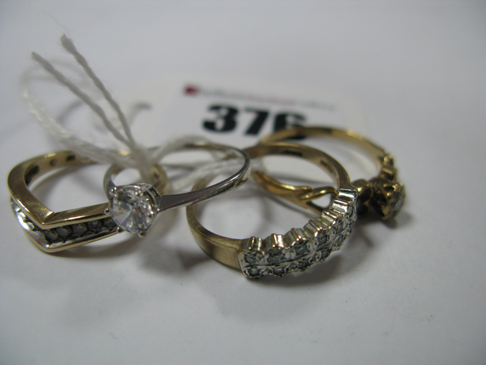 """Lot 376 - A Modern 9ct Gold Inset Wishbone Ring, a 9ct gold two row illusion set dress ring, stamped """"0.10"""", a"""