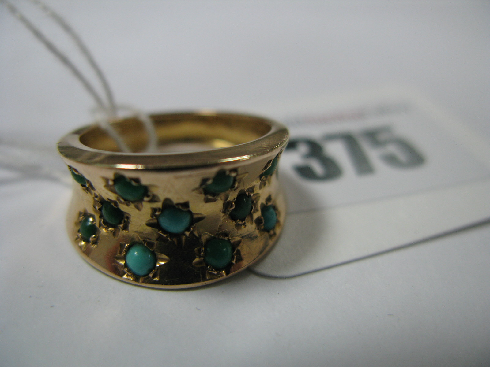 Lot 375 - A Turquoise Set Dress Ring.