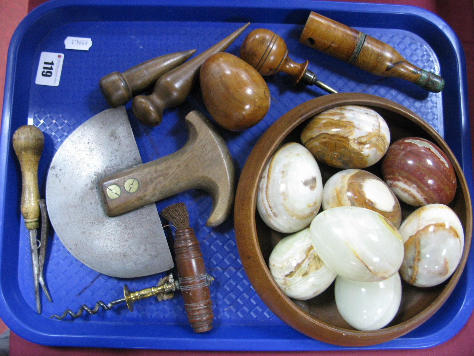 Lot 119 - A XIX Century Corkscrew, XIX Century Spice Chopper, Onyx hand coolers, walnut bowl etc:- One Tray