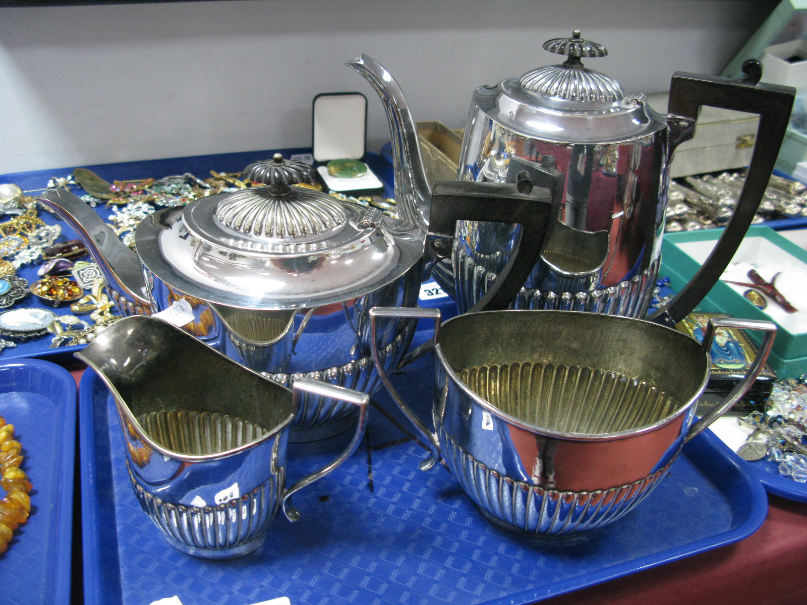 Lot 320 - A Plated Four Piece Tea Set, each of oval semi reeded form with angular loop handles. (4)