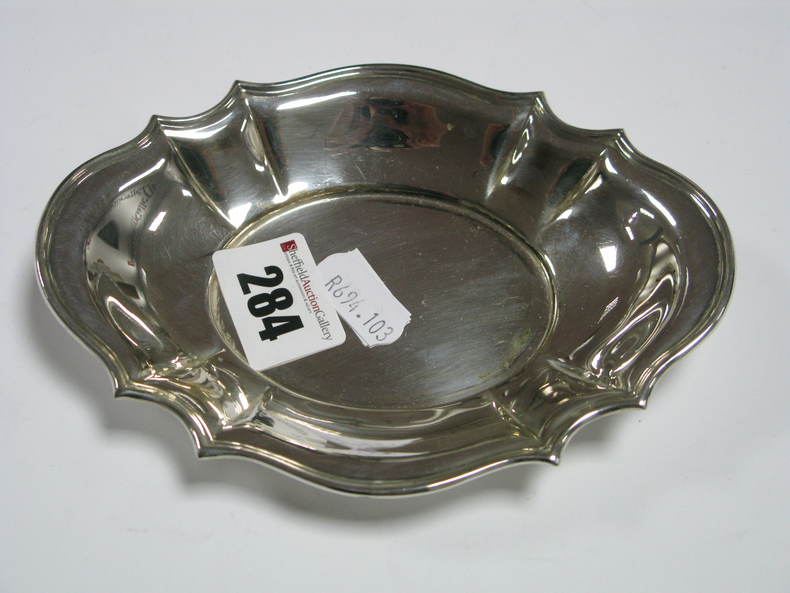 Lot 284 - A Hallmarked Silver Trinket Dish, of shaped oval form, 14.7cm wide.