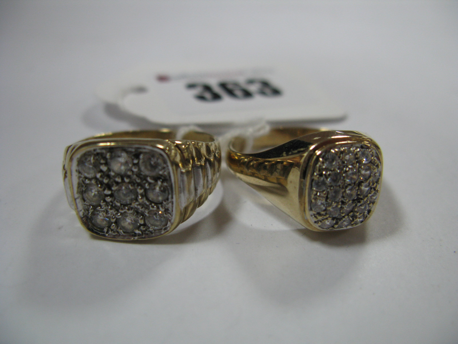 Lot 363 - A 9ct Gold Gent's Dress Ring, square inset to the centre, between textured watch bracelet style