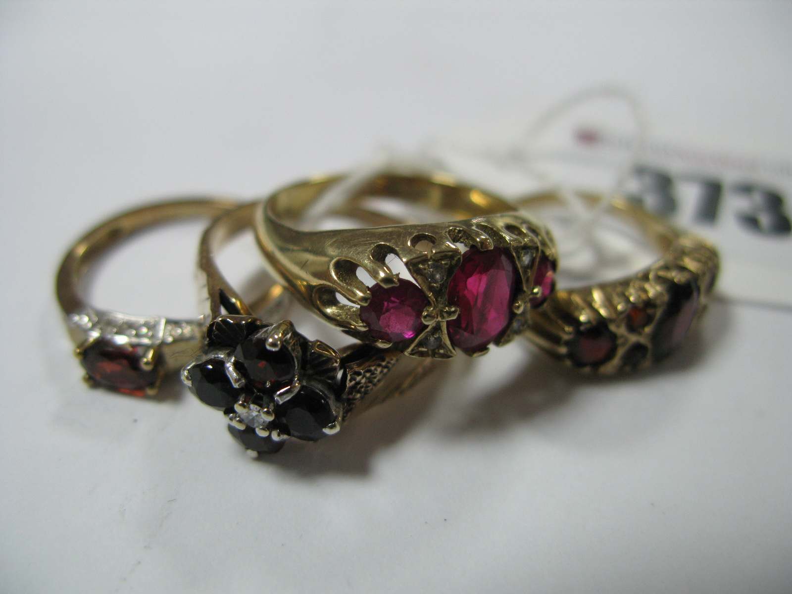 Lot 373 - A 9ct Gold Cluster Style Dress Ring, claw set highlights, between wide textured shoulders, a