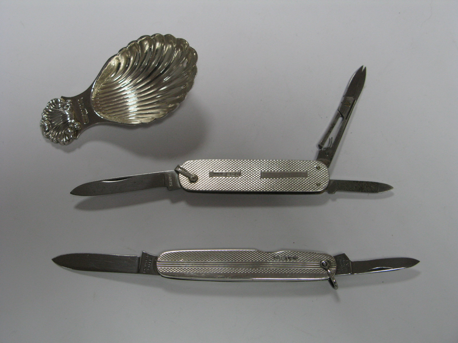 Lot 286 - A Multi Function Folding Pocket Knife, with hallmarked silver engine turned scales; a two blade
