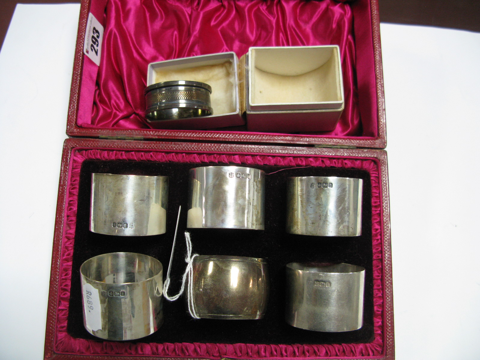 Lot 293 - A Matched Set of Five Hallmarked Silver Napkin Rings, together with another, each of plain design,