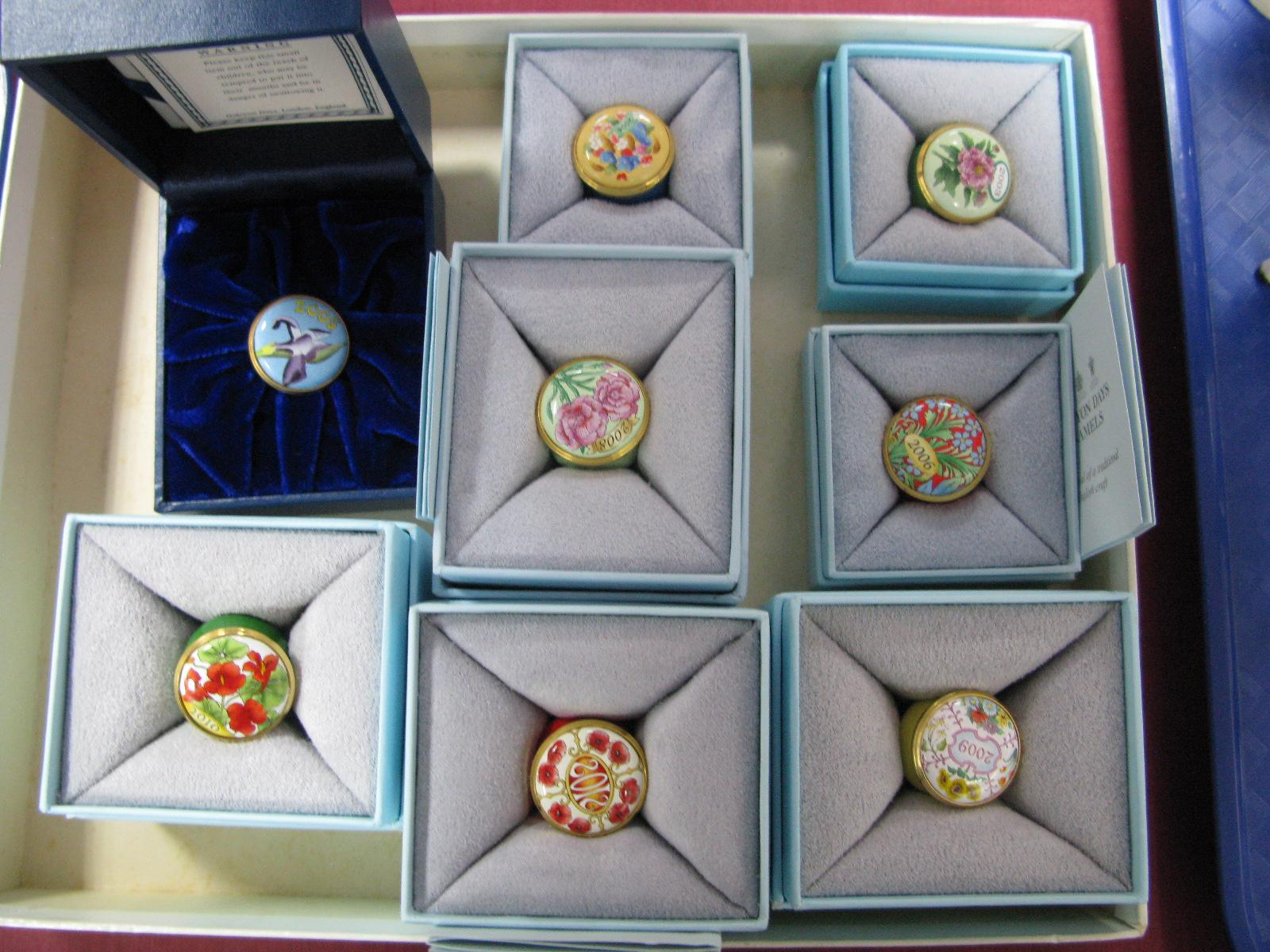 Lot 61 - Eight Halcyon Days Circular Enamel 'Year' Trinket Pots, 2003, 2004, 2005, 2006, 2008, 2009, 2010 and