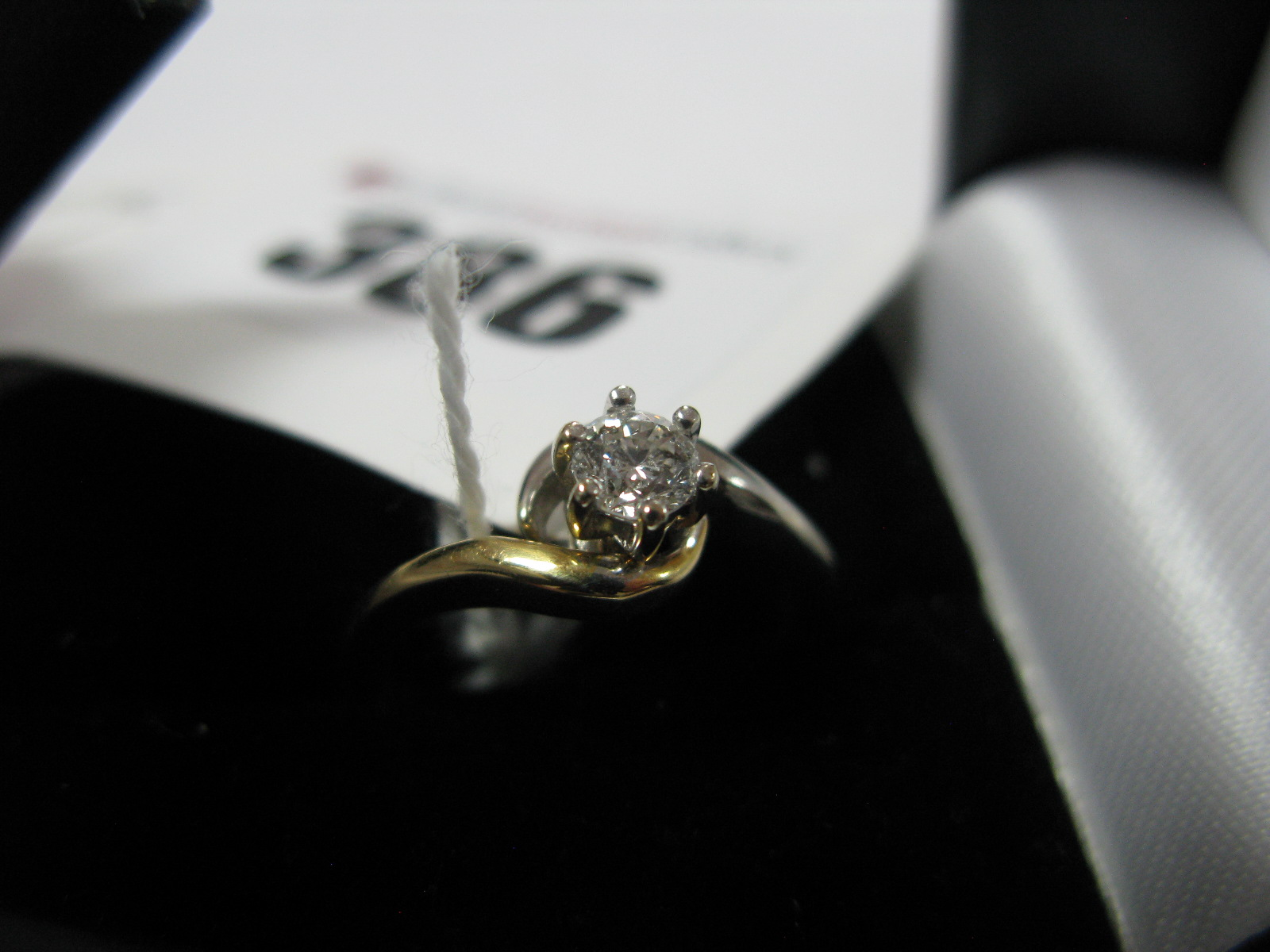 Lot 386 - A Modern 18ct Gold Single Stone Diamond Ring, the brilliant cut stone, claw set, between two tone