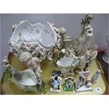 A XIX Century Fairings, Meissen Style Bowl, supported by three cupids with cross swords on base of