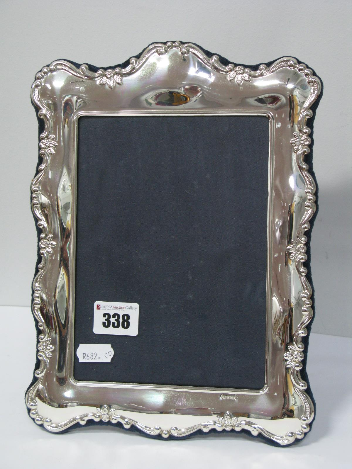Lot 338 - A Modern Hallmarked Silver Mounted Rectangular Photograph Frame, of shaped design, on plush blue
