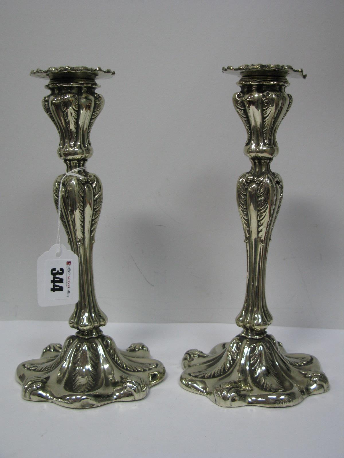 Lot 344 - A Pair of Decorative Continental Style Plated Candlesticks, each shaped base with stylised leaf
