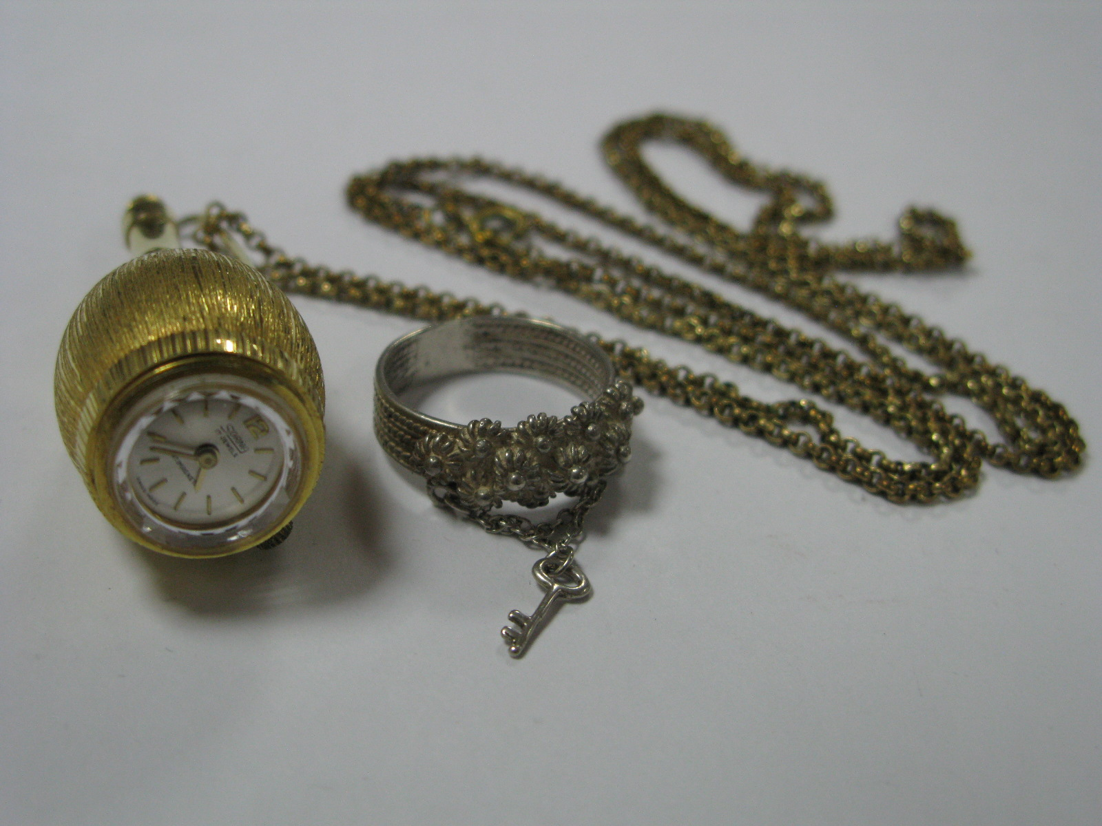 Lot 358 - Sorna; A Novelty Bottle Shape Watch Pendant, on belcher link chain; together with a decorative