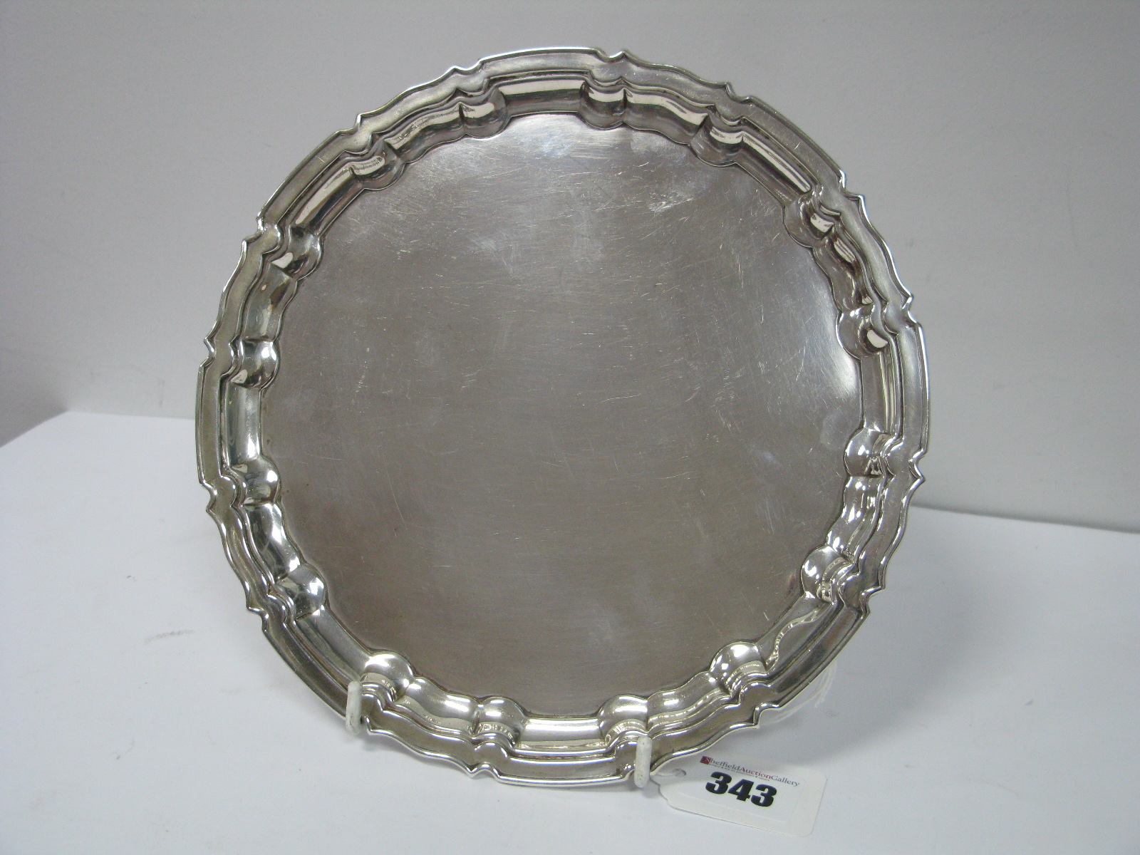 Lot 343 - A Hallmarked Silver Waiter, of shaped circular form, Messrs Hutton, Sheffield 1914, 20.5cm