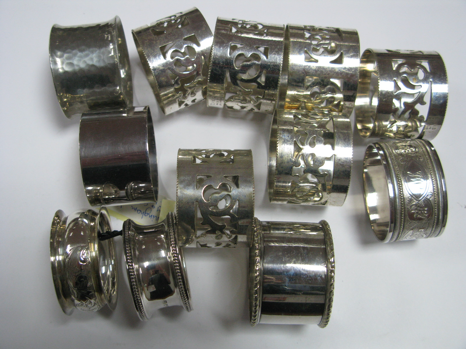 Lot 282 - Two Hallmarked Silver Napkin Rings; together with assorted plated examples.