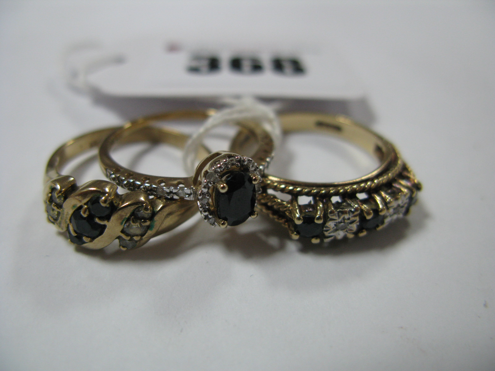 Lot 368 - A Modern 9ct Gold Cluster Ring, oval four claw set, within openwork inset border and shoulders,