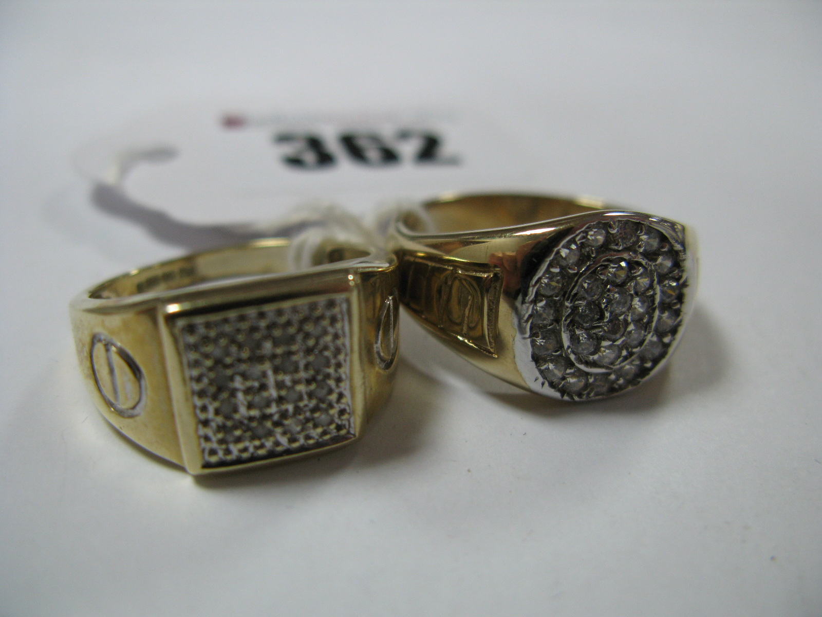Lot 362 - A 9ct Gold Gent's Dress Ring, circular inset highlights to the centre, between textured shoulders,