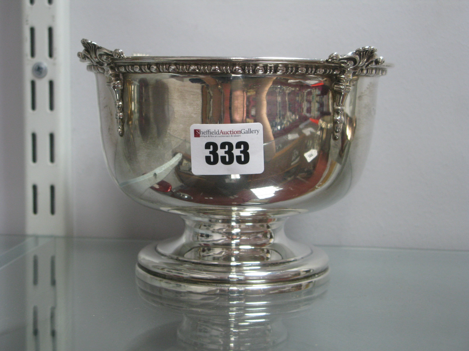 Lot 333 - A Hallmarked Silver Footed Bowl, with reed and reel border, 15.2cm diameter, Birmingham 1922.