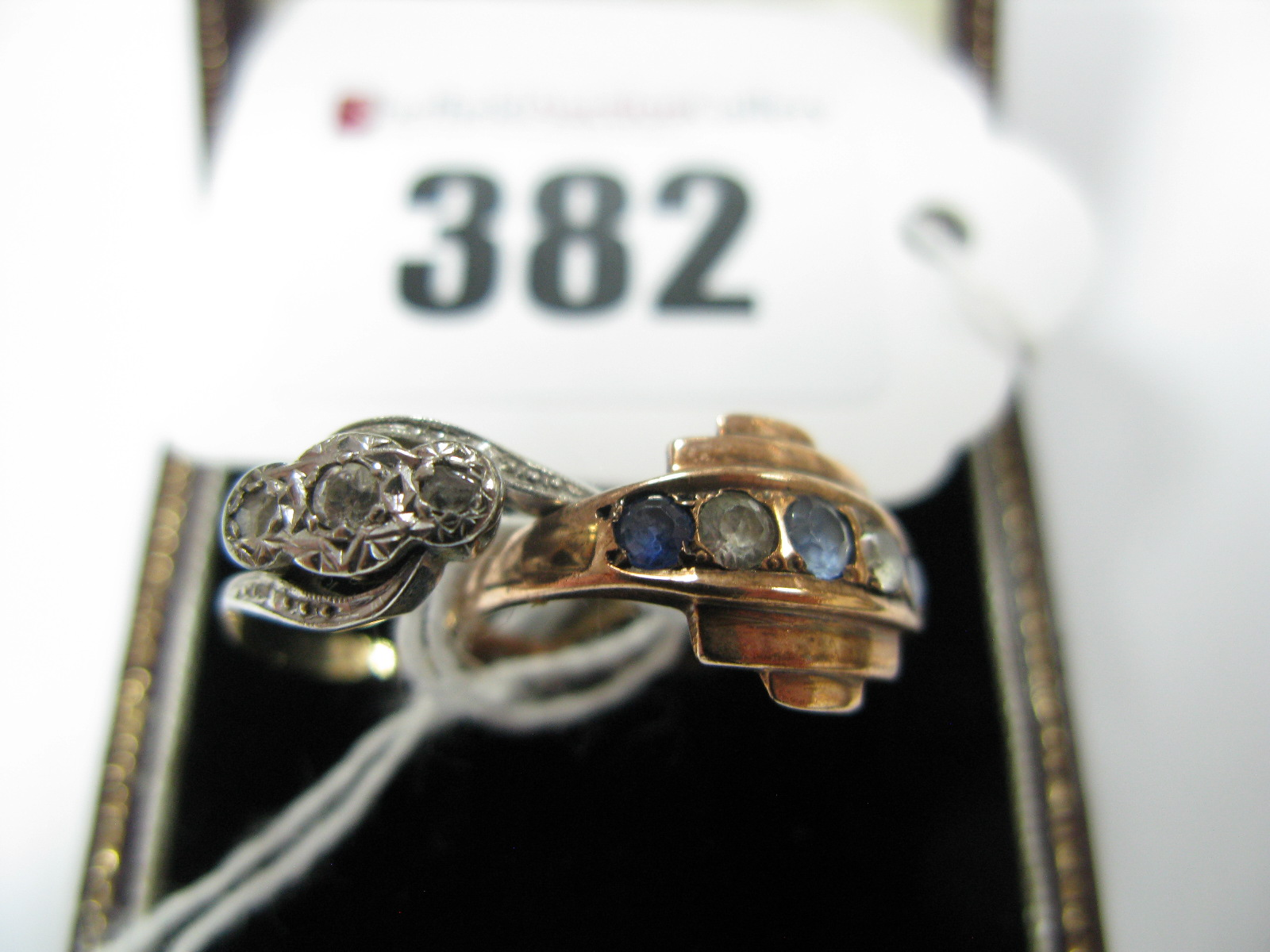 Lot 382 - An Illusion Set Dress Ring, textured crossover shoulders, stamped ''9ct Plat'', an Art Deco style