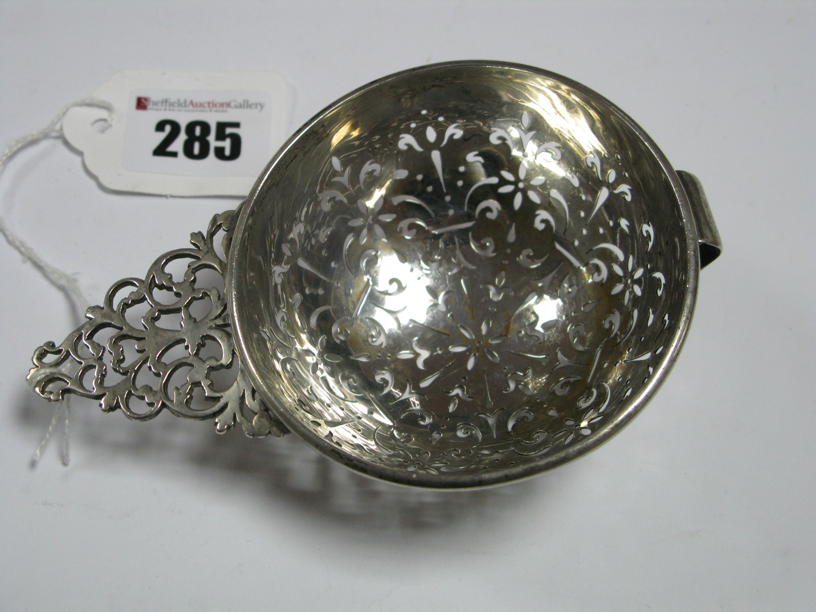 Lot 285 - A Hallmarked Silver Strainer, (marks pierced/incomplete) London 1927, modelled as an earlier fruit
