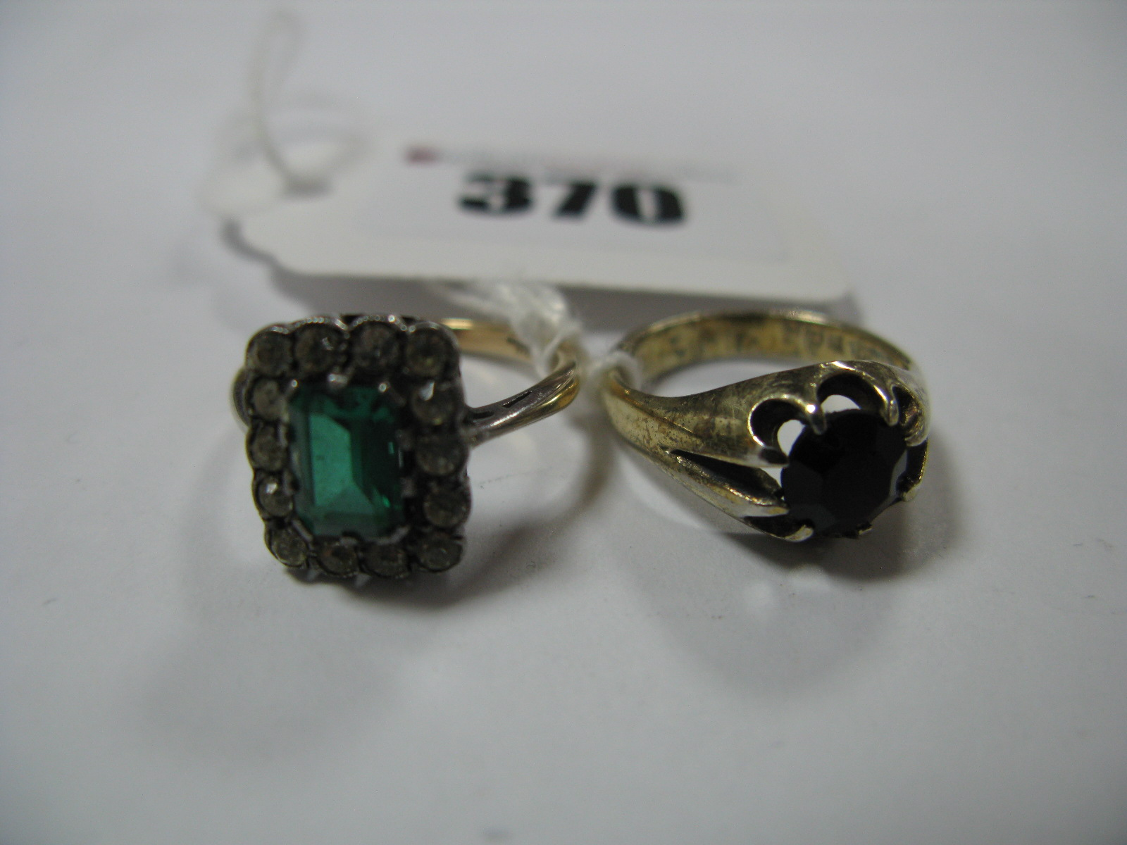 Lot 370 - A Rectangular Cluster Dress Ring, claw set centre, with collet set border, another dress ring. (2)
