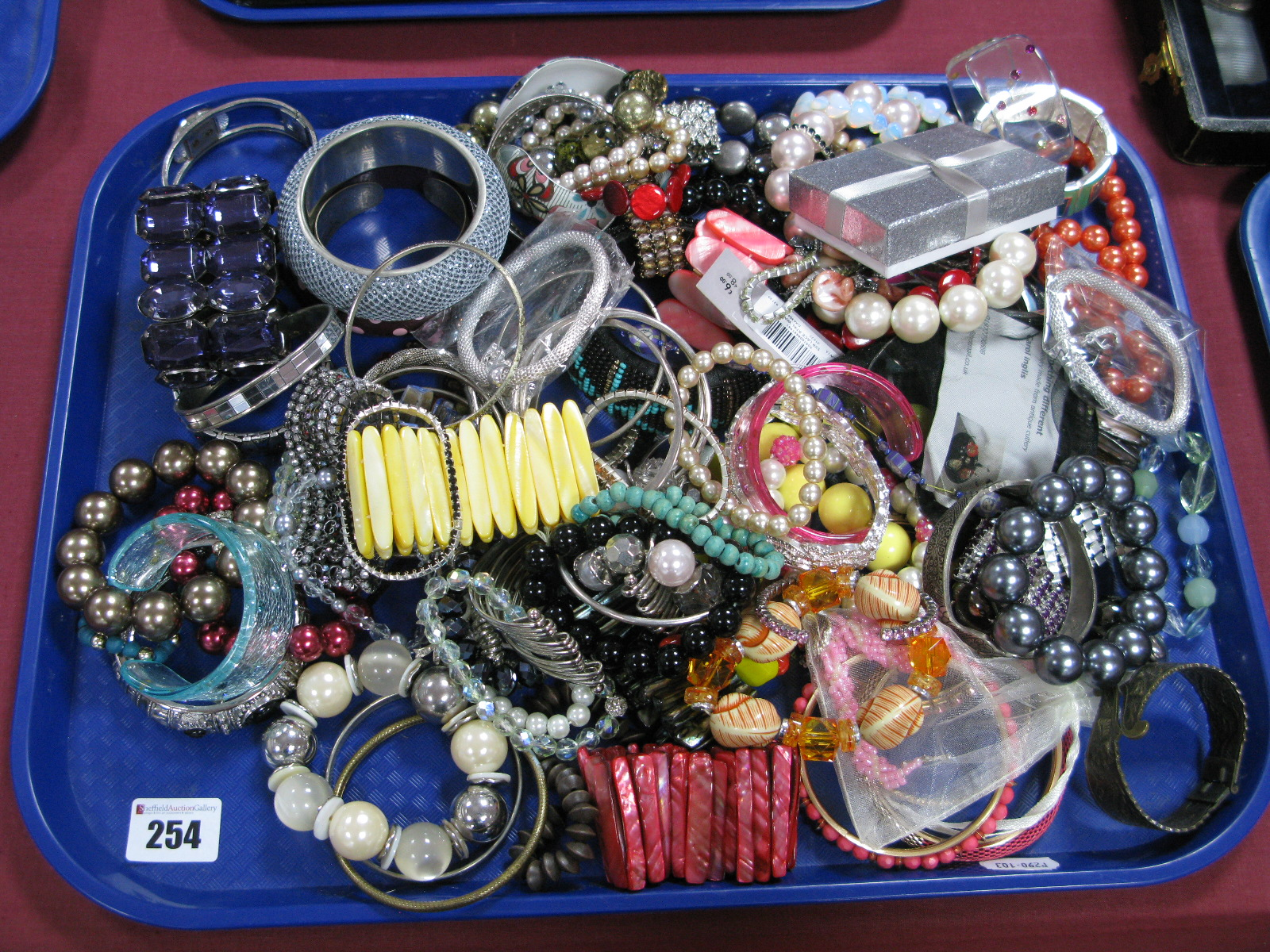 Lot 254 - A Selection of Various Style Costume Bangles and Bracelets:- One Tray