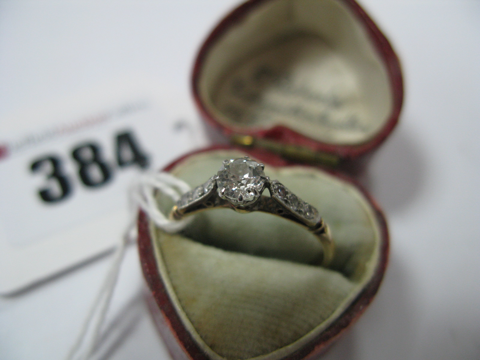 Lot 384 - A Single Stone Diamond Ring, the old cut stone claw set, between inset shoulders, stamped ''18ct