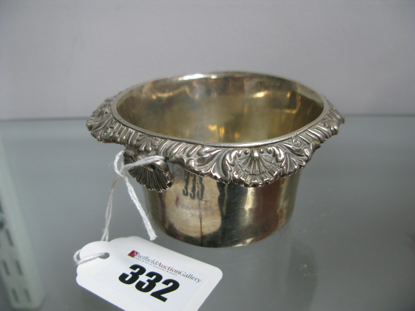 Lot 332 - A Hallmarked Silver Strainer, Rebecca Emes & Edward Barnard, with shell and gadrooned border.