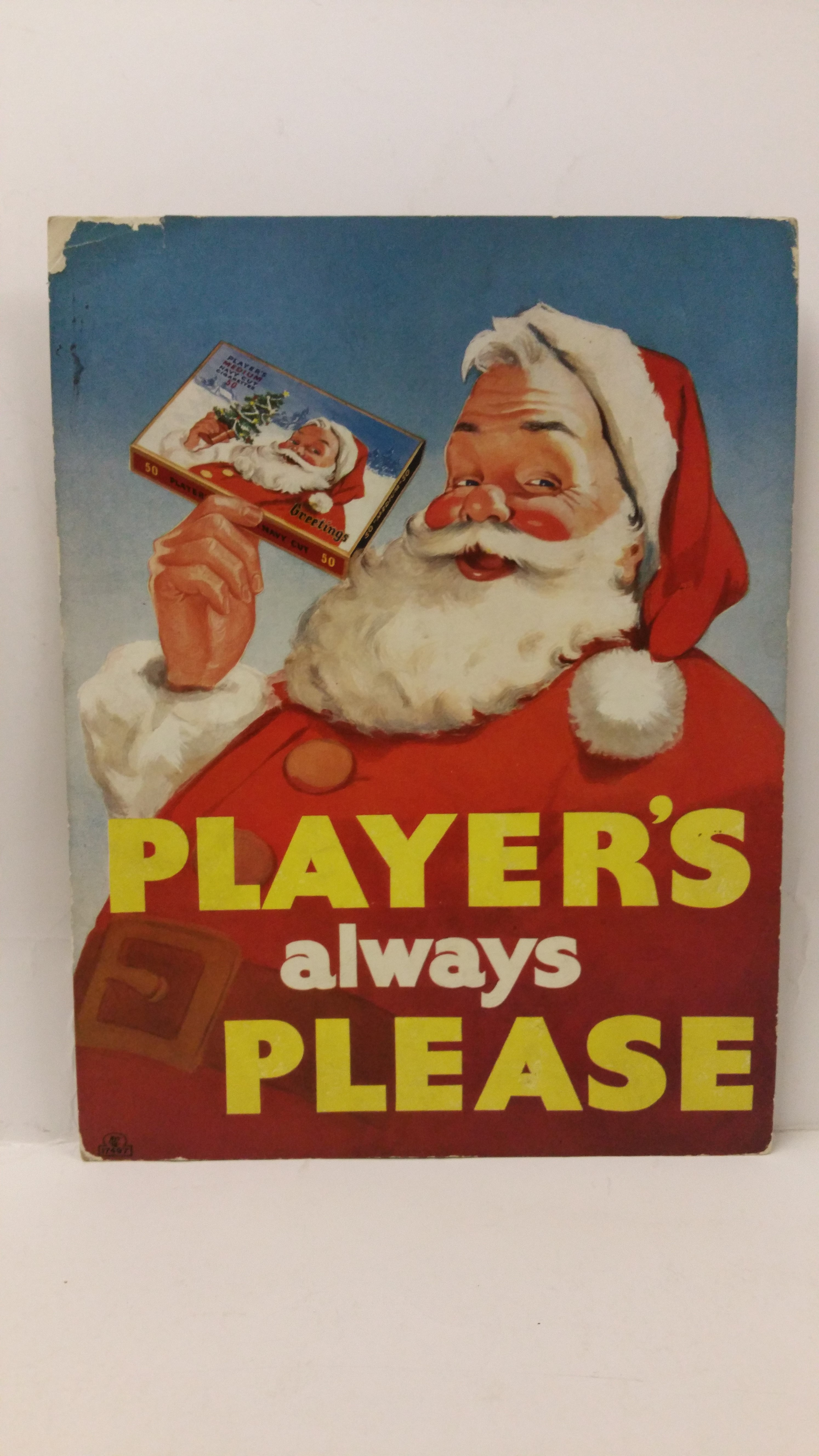 Lot 1133 - PLAYERS, cardboard showcard for Navy Cut Cigarettes, showing Father Christmas holding a box of