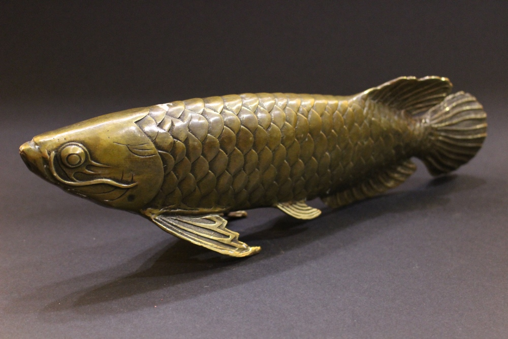 """Lot 250 - A BRASS ORNAMENT IN THE FORM OF A FISH, 11"""" x 2"""" x 3.75"""" approx"""
