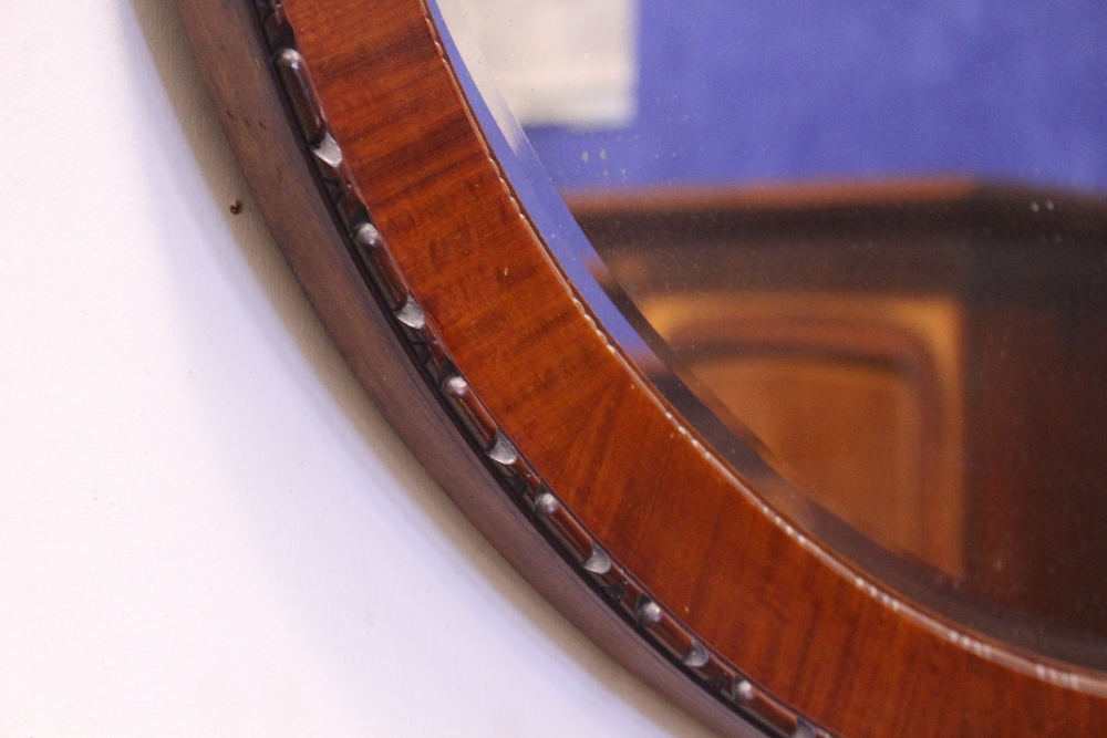 """Lot 170 - AN OVAL MAHOGANY WALL MIRROR, with gadrooned rim, 38"""" x 26.5"""" approx"""