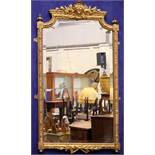 A VERY FINE 19TH CENTURY FRENCH GILT WALL MIRROR, with bevelled glass, decorated with floral and