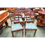 A SET OF 6 MAHOGANY REGENCY DINING ROOM CHAIRS, with lift up seats, and carved rose motif backs,