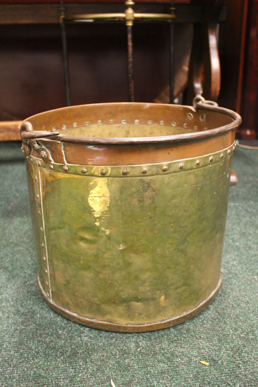 "Lot 360 - A BRASS & COPPER COAL / LOG BUCKET, with cast iron handle, beaded detail to rim and joining, 18"" x"