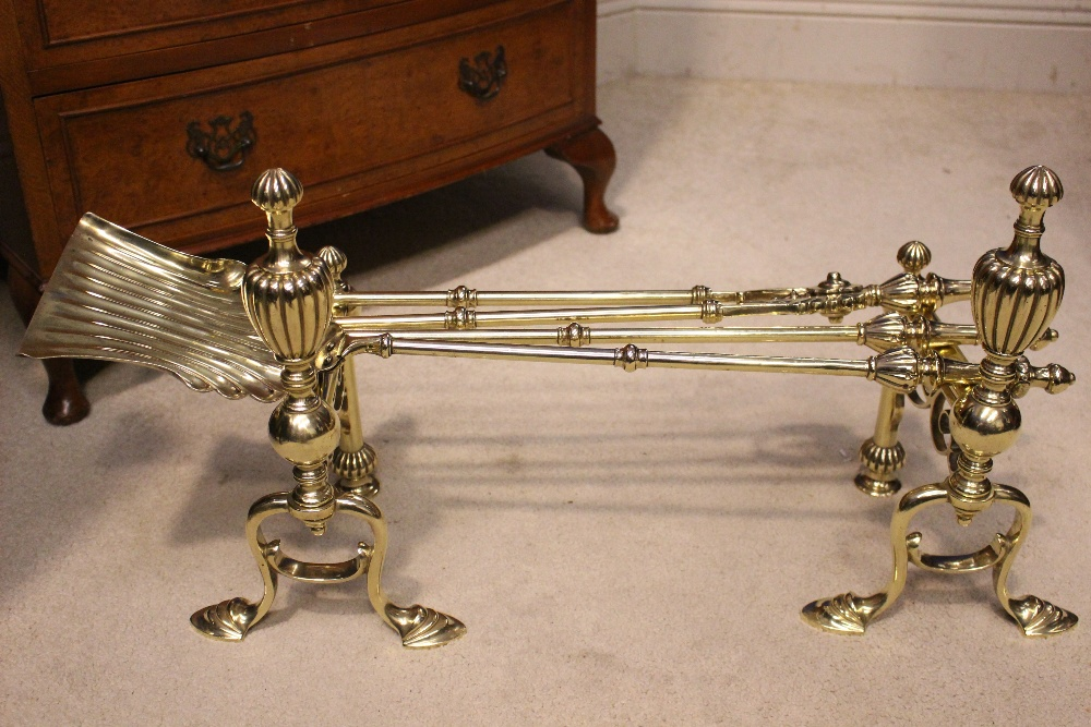 A VERY GOOD SET OF VICTORIAN BRASS FIRE IRONS, with matching fire dogs, includes shovel, poker and