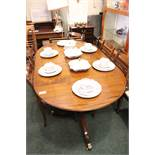 A TWO POD EXTENDABLE MAHOGANY DINING TABLE, with reeded rim, with turned column supports, and tripod