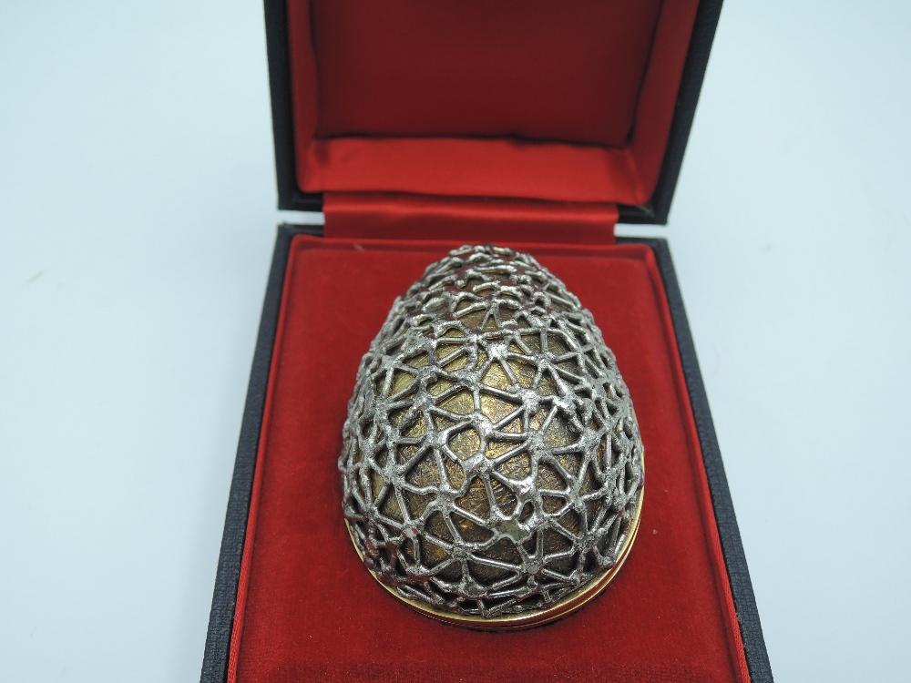 Lot 64 - Two 1960's cased Stuart Devlin silver gilt surprise eggs of exclusive unique designs, the first