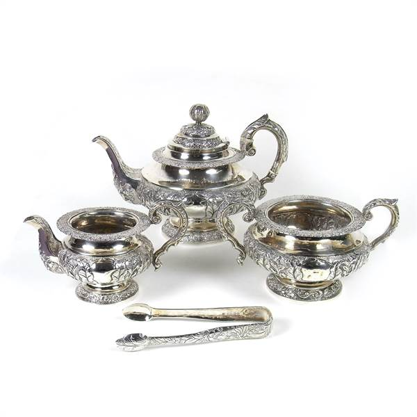 A William IV Irish silver three piece tea service and pair of sugar tongs. - Image 1