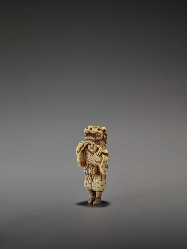 AN EARLY AND FINE IVORY NETSUKE OF A SHISHIMAI DANCER UnsignedJapan, late 18th century, Edo - Image 4 of 13
