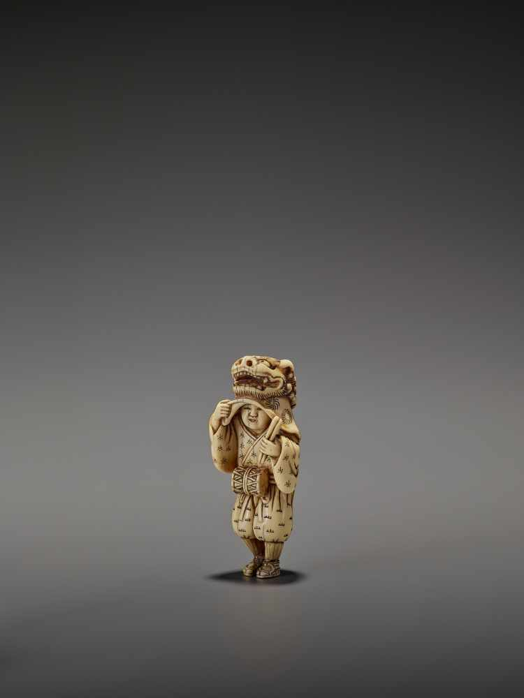 AN EARLY AND FINE IVORY NETSUKE OF A SHISHIMAI DANCER UnsignedJapan, late 18th century, Edo