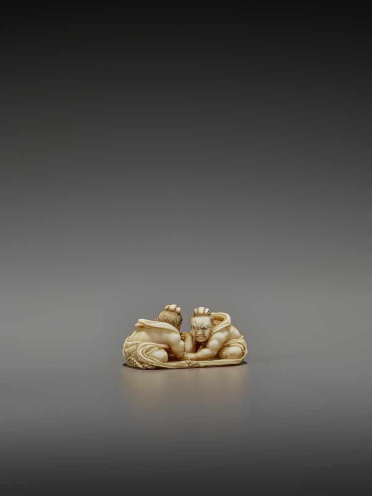 TOMOTAKA: AN IVORY NETSUKE OF TWO ARMWRESTLING NIO ON A WARAJI By Tomotaka, signed TomotakaJapan, - Image 2 of 11