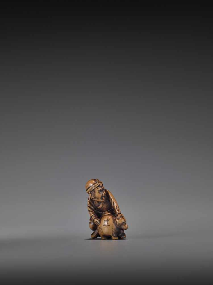 HIDEHISA: A RARE WOOD NETSUKE OF A THIEF STEALING THE MAGIC TANUKI KETTLE By Hidehisa, signed - Image 3 of 12