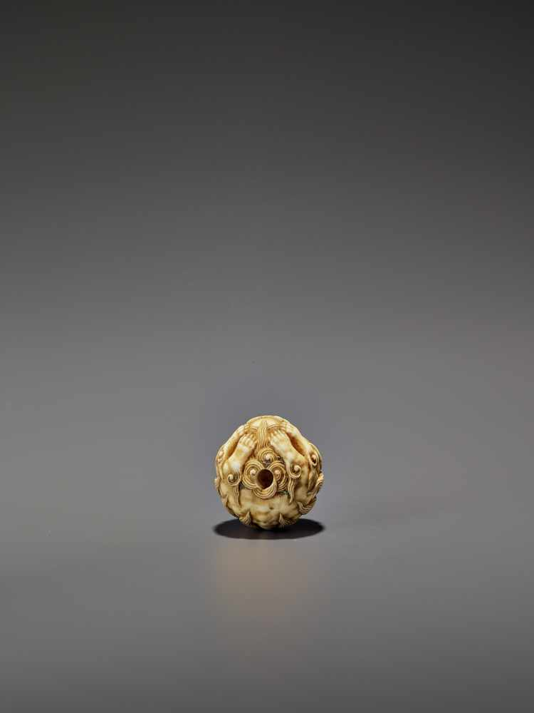 AN IVORY NETSUKE OF A SHISHI ROLLED INTO A BALL UnsignedJapan, 19th century, Edo period (1615-1868) - Image 9 of 9