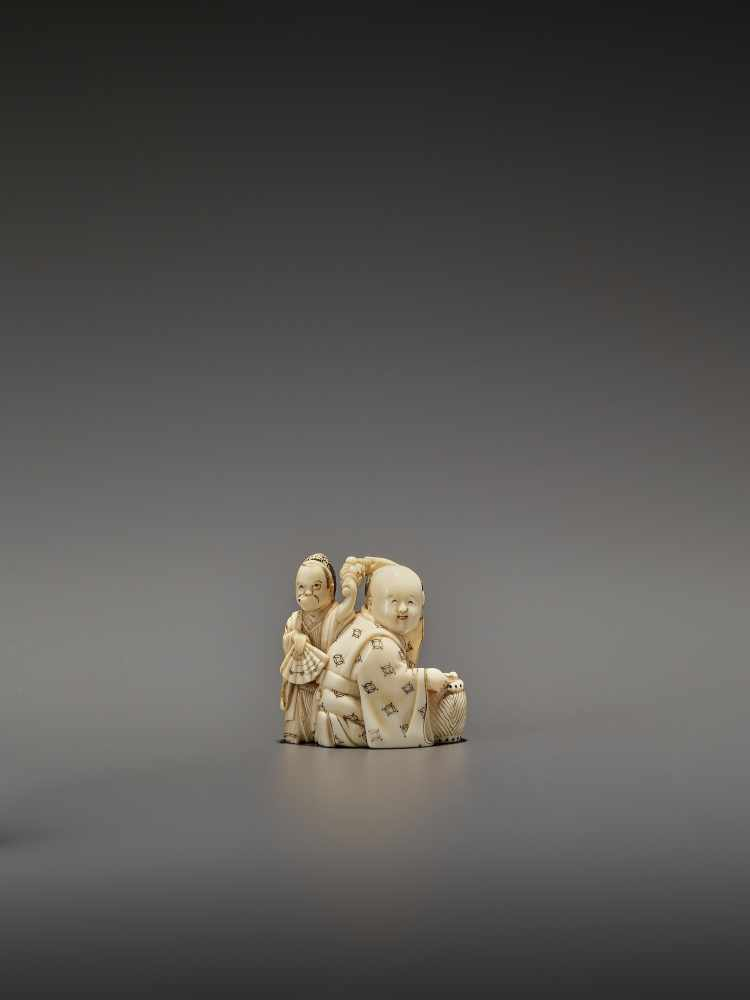 HOMIN: AN IVORY NETSUKE OF TWO BOYS AS MUSICIANS By Homin, signed Homin with kaoJapan, Edo/Tokyo,