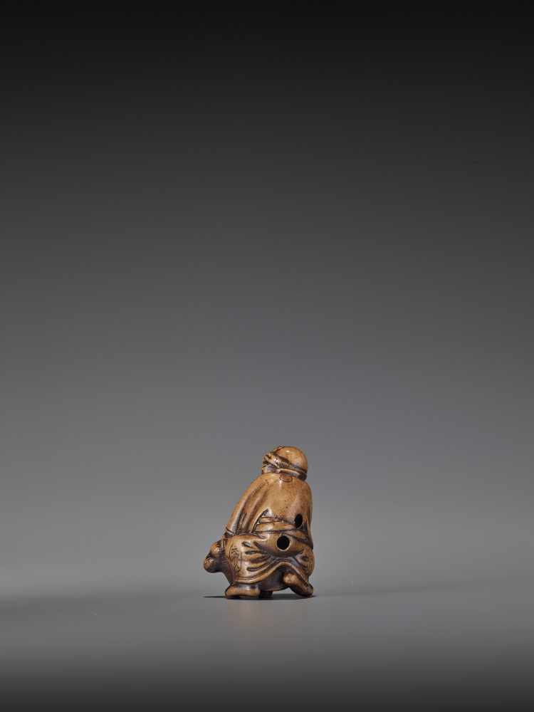 HIDEHISA: A RARE WOOD NETSUKE OF A THIEF STEALING THE MAGIC TANUKI KETTLE By Hidehisa, signed - Image 6 of 12