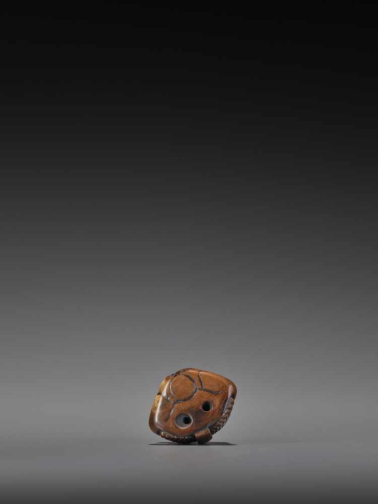 A WOOD NETSUKE OF A TENGU STIRRING MISO UnsignedJapan, 19th century, Edo period (1615-1868)A wood - Image 9 of 9