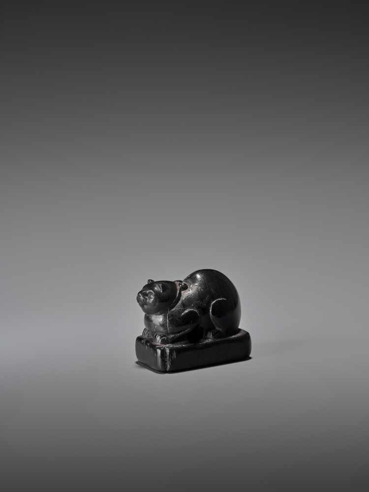 AN EARLY EBONY WOOD NETSUKE OF A WELL-FED CAT ON A BASE UnsignedJapan, early 18th century, Edo - Image 2 of 9