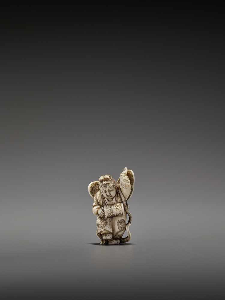 MASAHIRO: A VERY RARE IVORY NETSUKE OF A BUTTERFLY DANCER, KOCHO NO MAI By Masahiro, signed
