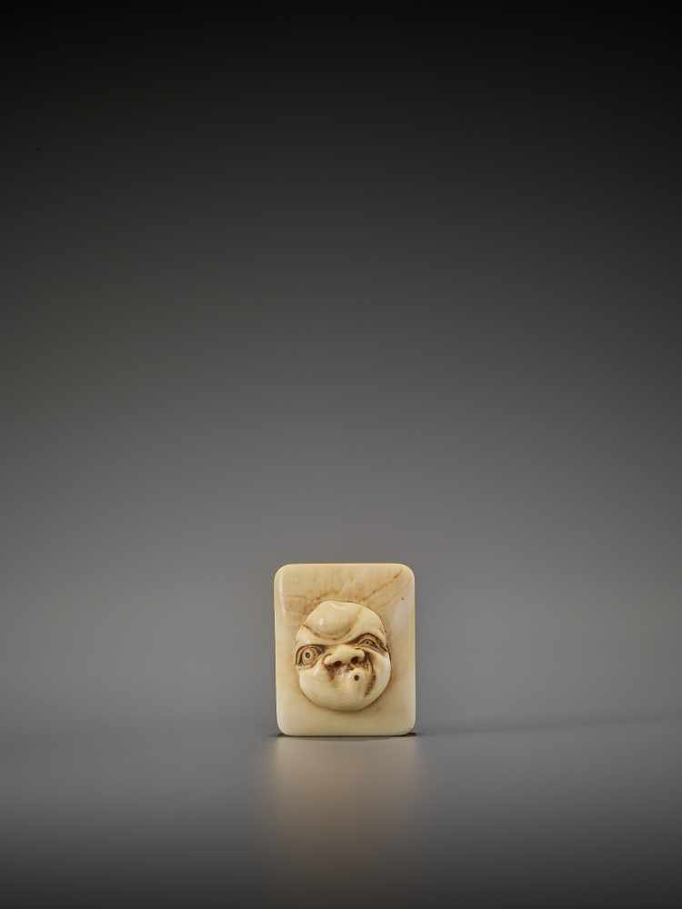 DORAKU: AN IVORY NETSUKE OF A MASK BOX WITH USOFUKI By Doraku(Sai), signed DorakuJapan, Osaka,