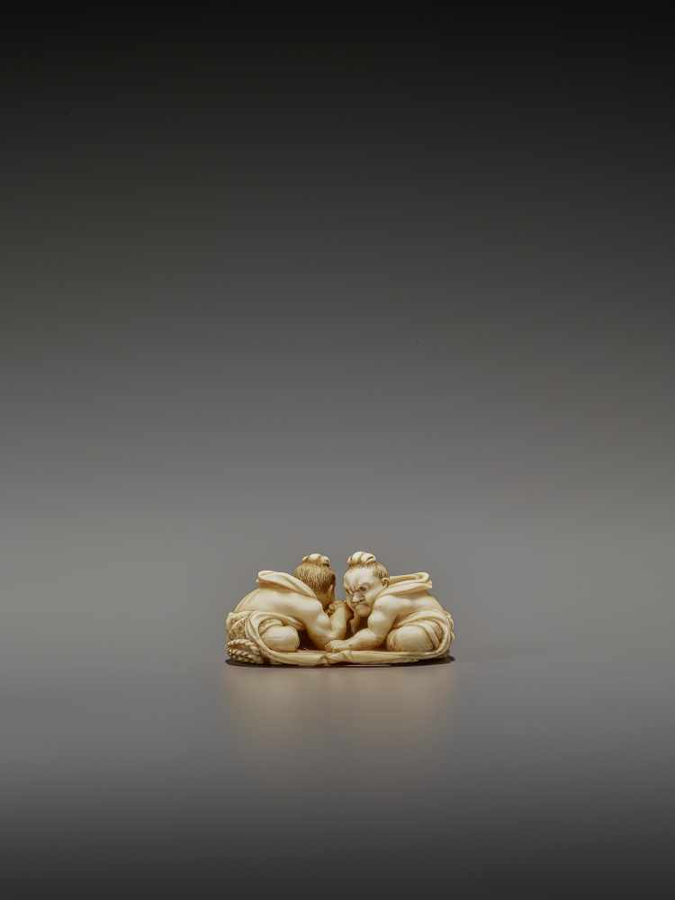TOMOTAKA: AN IVORY NETSUKE OF TWO ARMWRESTLING NIO ON A WARAJI By Tomotaka, signed TomotakaJapan, - Image 4 of 11